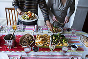 Members of a British family help themselves to  their turkey and vegetable lunch on Christmas Day, on 25th December 2020 in London, England.