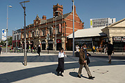 Street scene showing people near to Pool Meadow Bus Station and Hales Street in the UK City of Culture 2021 on 23rd June 2021 in Coventry, United Kingdom. The UK City of Culture is a designation given to a city in the United Kingdom for a period of one year. The aim of the initiative, which is administered by the Department for Digital, Culture, Media and Sport. Coventry is a city which is under a large scale and current regeneration.