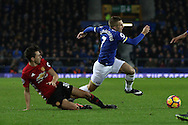 Gerard Deulofeu of Everton is tackled by Matteo Darmian of Manchester United. Premier league match, Everton v Manchester United at Goodison Park in Liverpool, Merseyside on Sunday 4th December 2016.<br /> pic by Chris Stading, Andrew Orchard sports photography.