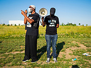 17 JUNE 2020 - NORWALK, IOWA: AKO ABDUL-SAMAD, an Iowa legislator and civil rights leader, (left) speaks to Black Lives Matter protesters in Elizabeth Holland Park in Norwalk. About 400 supporters of Black Lives Matter marched through Norwalk, IA, an upper class suburb of Des Moines Wednesday. Norwalk has a population of about 10,000 and, according to the US Census Bureau, is 97 percent white. The marchers were protesting police violence against people of color. The march was a reaction to the police killing of George Floyd in Minneapolis in May. The march was peaceful.        PHOTO BY JACK KURTZ