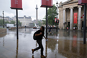 Scenes of a very quiet Trafalgar Square after a rain shower under coronavirus lockdown on 1st July 2020 in London, England, United Kingdom. As the July deadline approaces and government will relax its lockdown rules further, the central London remains very quiet, while some non-essential shops are allowed to open with individual shops setting up social distancing systems.