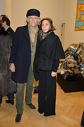 SIR BOB GELDOF and JEANNE MARINE at the opening private view of 'A Strong Sweet Smell of Incense - A portrait of Robert Fraser, held at the Pace Gallery, Burlington Gardens, London on 5th February 2015.