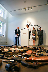 16 April 2014. Jonathan Ferrara Gallery, New Orleans, Louisiana. <br /> L/R; Jonathan Ferrara,  Officer Earl Johnson, LaToya Cantrell, Stacy Head and Susan Guidry at the Jonathan Ferrara Gallery to announce the 'Guns In The Hands Of Artists' project where artists take parts from 190 destroyed weapons acquired by the New Orleans Police department through a buy-back program and convert them into art.  <br /> Photo; Charlie Varley/varleypix.com