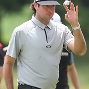 Bubba Watson, USA, on the 8th green during the first round of the Travelers Championship at the TPC River Highlands, Cromwell, Connecticut, USA. 19th June 2014. Photo Tim Clayton