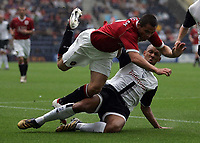 Photo: Paul Thomas.<br /> Preston North End v Manchester United. Pre Season Friendly. 29/07/2006.<br /> <br /> Phil Bardsley of Man Utd gets tackled by Jason Jarrett (R).