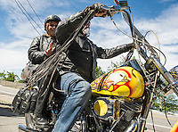 Vance Nash and Cyndie Urquhart are first time visitors to Laconia for Bike Week but the motorcycle they are riding on has seen 17 years of bike rally visits with Nash's dad.  Driving up towards Weirs Beach on Friday morning to begin their weekend stay.  (Karen Bobotas/for the Laconia Daily Sun)