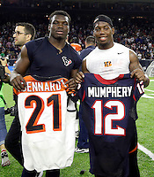 Houston Texans' Keith Mumphery (12) and Cincinnati Bengals' Darqueze Dennard (21) exchange jerseys after an NFL football game Saturday, Dec. 24, 2016, in Houston. The Texans won 12-10. (AP Photo/Sam Craft)