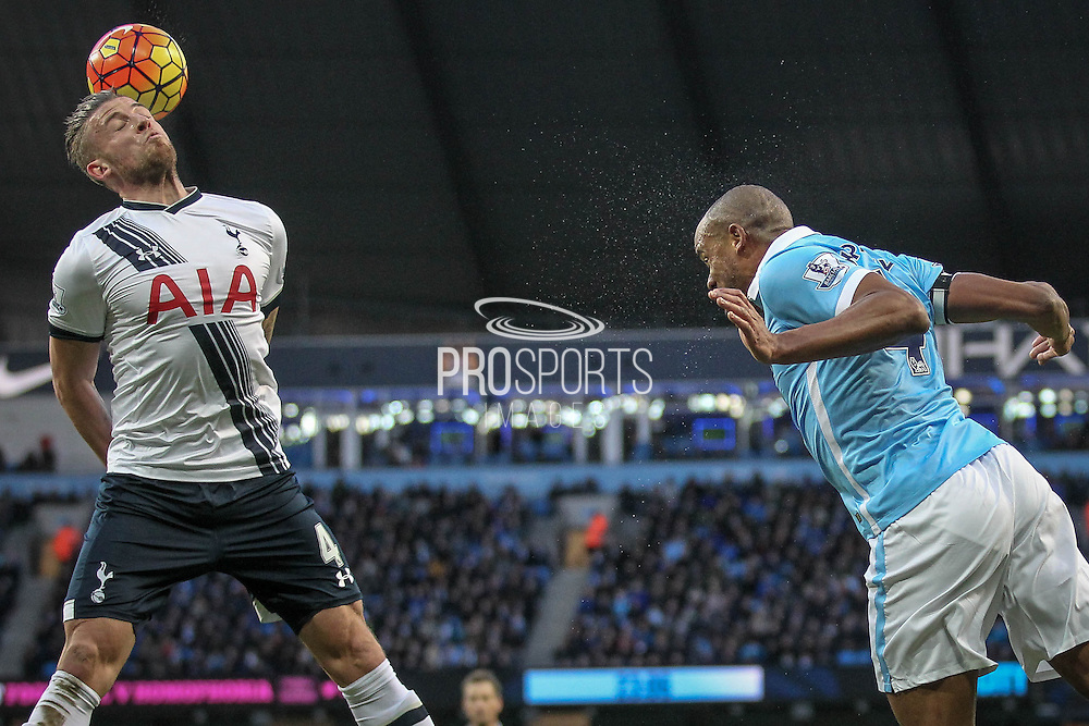 Toby Alderweireld (Tottenham Hotspur) tries to stop the header from Vincent Kompany (Captain) (Manchester City) during the Barclays Premier League match between Manchester City and Tottenham Hotspur at the Etihad Stadium, Manchester, England on 14 February 2016. Photo by Mark P Doherty.