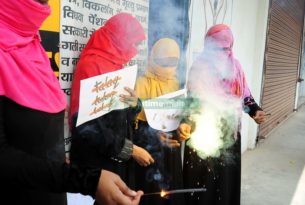 August 22, 2017 - Allahabad, Uttar Pradesh, India - Allahabad: Muslim women celebrate after supreme court decision on Triple Talaq in Allahabad on 22-08-2017. The Supreme Court today declared in a majority judgement that the Muslim practice of triple talaq or instant divorce by uttering ''talaq (divorce)'' three times ''illegal and sinful''. Triple talaq''is not integral to religious practice and violates constitutional morality'', said the court. The five judges, including Chief Justice JS Khehar, are from major faiths in India -- Hinduism, Christianity, Islam, Sikhism and Zoroastrianism. (Credit Image: © Prabhat Kumar Verma via ZUMA Wire)