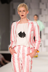 © Licensed to London News Pictures. 01/06/2014. London, England. Collection by Cat Potter from the Manchester School of Art. Graduate Fashion Week 2014, Runway Show at the Old Truman Brewery in London, United Kingdom. Photo credit: Bettina Strenske/LNP
