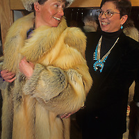 A shopper tries on furs at a store in the Mountain Mall at Montana's Big Sky Resort.