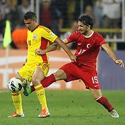 Turkey's Mehmet Topal (R) and Romania's Adrian Mutu during their FIFA World Cup 2014 qualifying soccer match Turkey betwen Romania at Sukru Saracoglu stadium in Istanbul october 12, 2012. Photo by TURKPIX