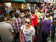 17 NOVEMBER 2016 - GEORGE TOWN, PENANG, MALAYSIA:  People walk through a crowded market in George Town, Penang, Malaysia. George Town is a UNESCO World Heritage city and wrestles with maintaining its traditional lifestyle and mass tourism.       PHOTO BY JACK KURTZ
