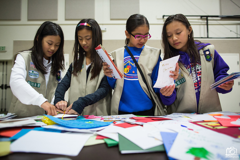Troop 60083 Girl Scouts Crystal Cheng, 11, Emi Wong, 11, Vyomi Seth, 10, and Kassidy Lattanaphom, 11, from left to right, sort and bundle Holiday Cards created special for the U.S. Military during the Girl Scout USA of Northern California Operation Holiday Cards packing event at Mount Olive Ministries in Milpitas, California, on November 18, 2015. (Stan Olszewski/SOSKIphoto)