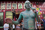 Members from the London Wonderground sideshow freakshow perform a free show to entice in customers. The Lizard Man introduces the acts and sells the show 'on the inside'. The South Bank is a significant arts and entertainment district, and home to an endless list of activities for Londoners, visitors and tourists alike.