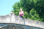 EXCLUSIVE<br /> <br /> Glamour model gran Sharon Perkins with 32MM breasts pictured in Bulgaria with her dogs as she takes a stroll in Bulgaria<br /> <br /> Photo shows: Sharon pictured at a bridge waiting for dogs in Bulgaria<br /> ©Exclusivepix Media
