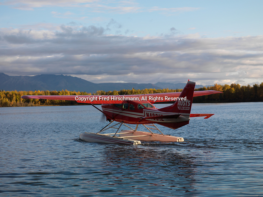 Rust's Flying Service Cessna 206 on floats taxiing on Lake Lucille, Wasilla, Alaska.