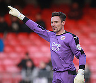 Crawley Town goalkeeper Darryl Flahaven organises his defence during the Sky Bet League 2 match between Crawley Town and Bristol Rovers at the Checkatrade.com Stadium, Crawley, England on 21 November 2015. Photo by Bennett Dean.