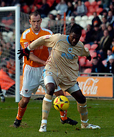 Photo: Jed Wee.<br />Blackpool FC v Bristol City. Coca Cola League 1. 21/01/2006.<br />Bristol's Bas Savage (R) holds off Blackpool's Tony Butler.