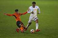 Leroy Fer of Swansea city is challenged by Morgan Gibbs-White of Wolverhampton Wanderers (l).  The Emirates FA Cup, 3rd round replay match, Swansea city v Wolverhampton Wanderers at the Liberty Stadium in Swansea, South Wales on Wednesday 17th January 2018.<br /> pic by  Andrew Orchard, Andrew Orchard sports photography.