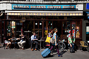 Tourists pass the Charles Dickens Coffee House in Covent Garden, London.