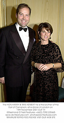 The HON.HARRY & MRS HERBERT he is the brother of the Earl of Carnarvon, at a dinner in London on 14th November 2001.	OUF 11