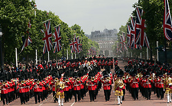 The Royal procession makes its way up The Mall from Horse Guards Parade, central London to Buckingham Palace following the Trooping the Colour ceremony as the Queen celebrates her official birthday today.