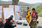 fire fighters Command and control This committee has representatives from various organizations such as police, fire fighters, first aid and military. This committee coordinates the activities of all the units to a successful resolution of the crisis Photographed in Israel