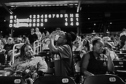 BIRMINGHAM, AL – JUNE 13, 2015: A mother and her daughter attend a Birmingham Barons minor league baseball game.