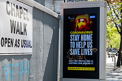 Coronavirus Covid-19 warning sign displayed on an electric advertising hoarding located at the bottom of Fargate in Sheffield South Yorkshire<br /> <br /> 24 April 2020<br /> <br /> www.pauldaviddrabble.co.uk<br /> All Images Copyright Paul David Drabble - <br /> All rights Reserved - <br /> Moral Rights Asserted -