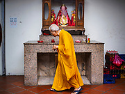 21 AUGUST 2018 - GEORGE TOWN, PENANG, MALAYSIA:  A priest in Kuan Yin Temple, the oldest Chinese temple in George Town, Penang.     PHOTO BY JACK KURTZ