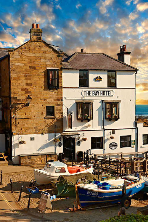 Fishing boats & the Bay Hotel of historic fishing village of Robin Hood's Bay, Near Whitby, North Yorkshire, England. .<br /> <br /> Visit our ENGLAND PHOTO COLLECTIONS for more photos to download or buy as wall art prints https://funkystock.photoshelter.com/gallery-collection/Pictures-Images-of-England-Photos-of-English-Historic-Landmark-Sites/C0000SnAAiGINuEQ