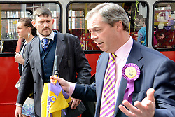 © Licensed to London News Pictures. 26/04/2012.LONDON,  UK (L-R)  GAWAIN TOWLER and Party leader Nigel Farage. Gawain Towler who is also a UKIP candidate and the party's top spin doctor has caused controversy today after making comments about a British Asian newspaper journalist. File picture dated 26/04/2012 as The UK Independence Party (UKIP) local election campaign was launched at St Stephen's Club, Central London. . Photo credit : Stephen Simpson/LNP