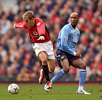 Photo. Jed Wee.<br /> Manchester United v Manchester City, FA Barclaycard Premiership, Old Trafford, Manchester. 13/12/03.<br /> Manchester United's Phil Neville (L) leaves Manchester City's Nicolas Anelka in his wake.