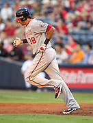 ATLANTA, GA - AUGUST 30:  Left fielder Michael Morse #38 of the Washington Nationals rounds the bases after hitting a second inning home run during the game against the Atlanta Braves at Turner Field on August 30, 2011 in Atlanta, Georgia.  (Photo by Mike Zarrilli/Getty Images)