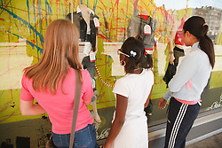 Teenage girls window-shopping.