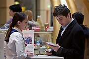 Moscow, Russia, 19/03/2005..Citibank staff interview shoppers and sign up new clients at the bank's promotional kiosks in the upmarket Atrium shopping mall.