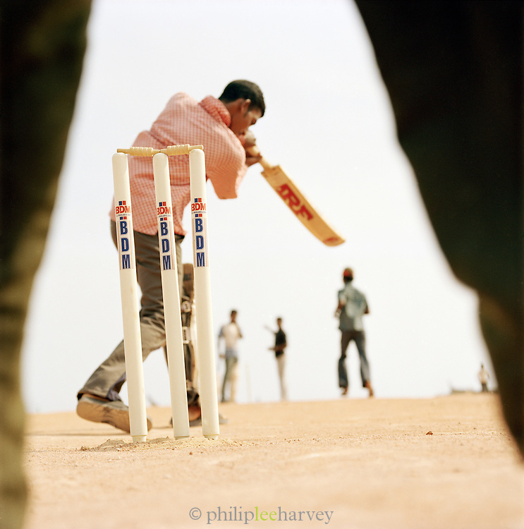 Beach cricket, Odayam Beach, Kerala, India