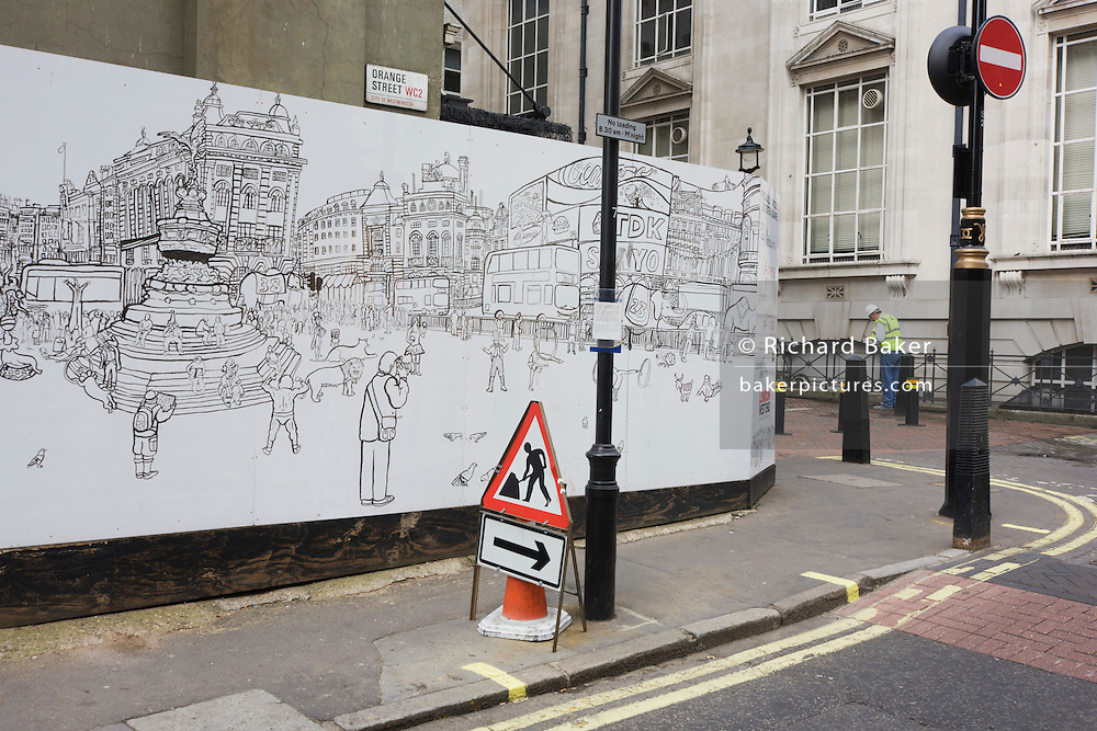 A construction hoarding showing Piccadilly Circus figures screens off a site near a workman