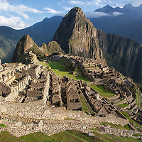 View over Machu Picchu just after sunrise with Huayna Picchu Mountain at the background.
