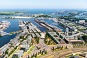 Nederland, Noord-Holland, Amsterdam, 29-06-2018; Zeeburg, Rietlandpark, voormalige Stadsrietlanden, ingang Piet Heintunnel. KNSM eiland, Sporenburg, Borneo-eiland, Cruquiuseiland (vlnr). IJburg, Zeeburgereiland.<br /> Former eastern port area, now residential area.<br /> <br /> luchtfoto (toeslag op standard tarieven);<br /> aerial photo (additional fee required);<br /> copyright foto/photo Siebe Swart