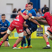 DUBLIN, IRELAND: October 16:  James Ryan #5 of Leinster is tackled by Sam Lousi #4 of Scarlets and Blade Thomson #8 of Scarlets during the Leinster V Scarlets, United Rugby Championship match at RDS Arena on October 16th, 2021 in Dublin, Ireland. (Photo by Tim Clayton/Corbis via Getty Images)