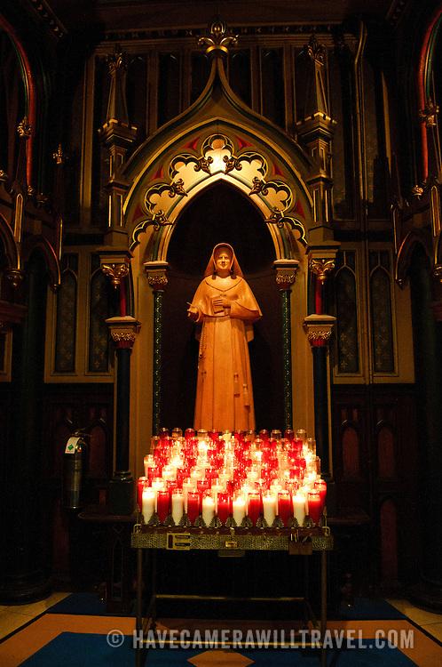 A statue of a nun in Basilique Notre-Dame de Montreal.