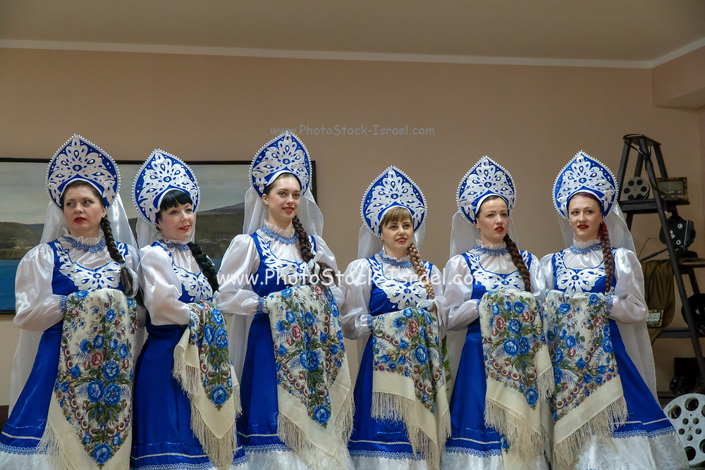 Russian women in traditional costumes in Barentsburg, a Russian coal mining settlement in Billefjorden, Spitsbergen, Norway
