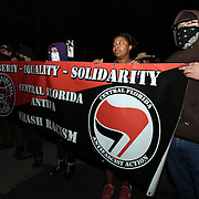 A group of supporters holds a sign during an Occupy Orlando public demonstration in support of Occupy Wall Street gatherings across the country, at the Orange County History Center on Wednesday, October 5, 2011 in Orlando, Florida. (AP Photo/Alex Menendez)