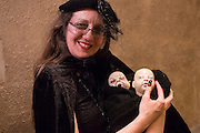 A woman with two dolls, one of which appears to be demonic.