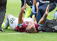 Football - 2018 / 2019 Premier League - West Ham United vs. Tottenham Hotspur<br /> <br /> Andriy Yarmolenko (West Ham United) throws his arms back as he lays injured shortly before being carried off with an ankle injury at the London Stadium<br /> <br /> COLORSPORT/DANIEL BEARHAM