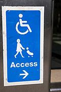 Blue sign for disabled and push-chair access to a commercial building in Canary Wharf, London, United Kingdom.