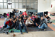 Greece . Chios Island, one of the places where refugees from Turkey land en route to Northern Europe. Tampakika camp, a reception centre, in an old factory only used now when there are lots of arrivals. A Yazidi family wait.
