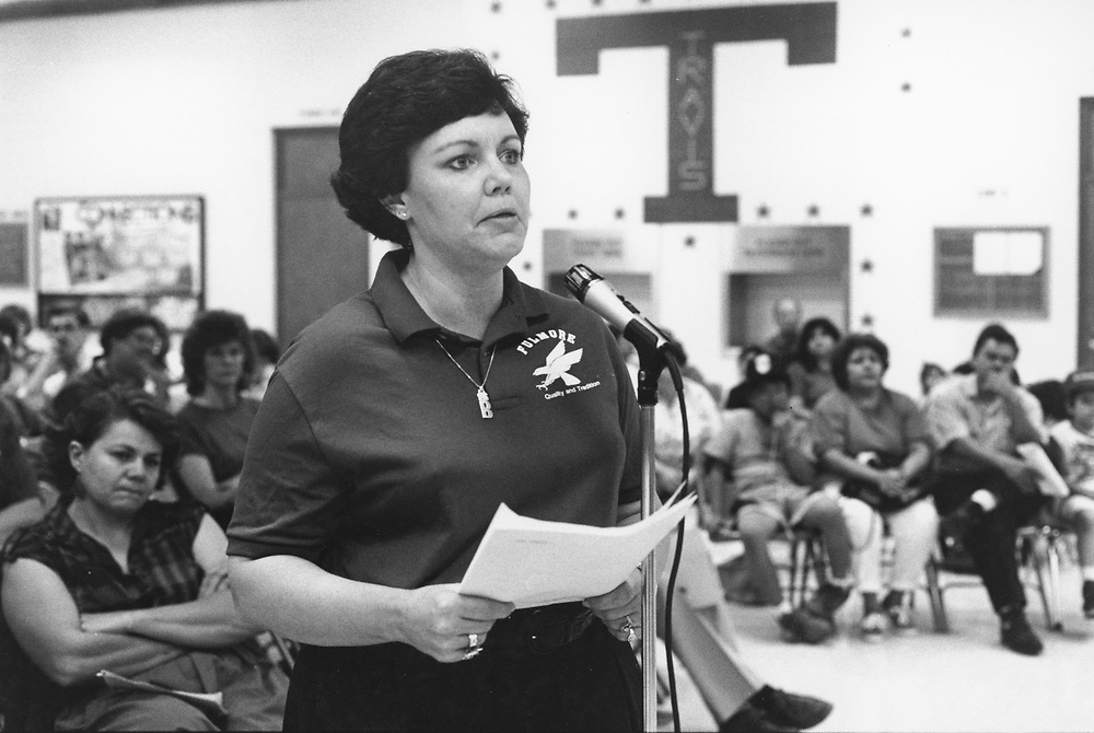 ©1992 Public hearing at Travis High School regarding closing of the school due to low enrollment numbers.  Teachers and students testifying to the school board.